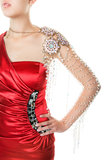Fashion Jewelry. Fashion model in red dress with expensive clear crystal arm piece.  Shot on white background Royalty Free Stock Images