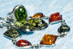 Fashion Jewelry with Amber. Vintage silver plated jewelry with colorful synthetic amber Stock Images