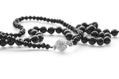 Fashion jewelry beautiful black beads on white background Stock Images