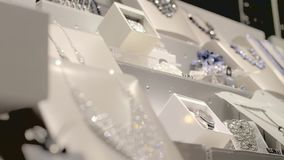 Jewelry Store Window. Fashion jewelry displayed in a jewelry store window. Retail industry concept stock video footage
