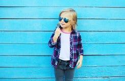 Fashion kid in city, stylish child wearing a sunglasses Stock Photo