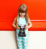 Fashion kid concept - little girl child with old retro vintage Royalty Free Stock Photography