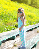 Fashion kid concept - little girl child wearing a t-shirt Royalty Free Stock Photos