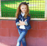 Fashion kid concept - stylish little girl child wearing a jeans Royalty Free Stock Photography