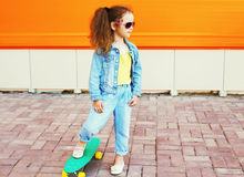 Fashion kid concept - stylish little girl child wearing a jeans Royalty Free Stock Photo
