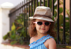 Fashion kid girl in glasses and hat outdoors Royalty Free Stock Photo