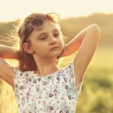 Fashion kid girl relaxing in fashion sunglasses on summer nature Royalty Free Stock Photography