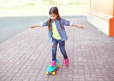 Fashion kid, little girl riding on skateboard Stock Photography