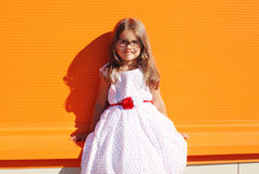 Fashion kid, portrait of beautiful little girl in white dress Stock Photo