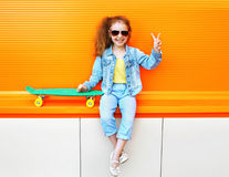 Fashion kid. Stylish little girl child wearing a jeans clothes Stock Photos