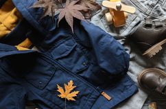 Fashion kids blue coat, brown leather shoe, denim pants and acce Stock Image