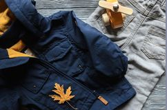 Fashion kids blue coat, denim pants and accessories. autumn conc. Ept Royalty Free Stock Photo