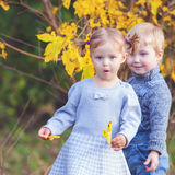 Fashion kids outdoor at fall season. Has date Royalty Free Stock Image