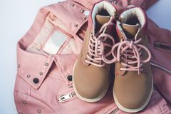Kids pink coat and shoes. Fashion kids pink coat and shoes Royalty Free Stock Images