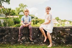 Fashion kids posing in beautiful garden Royalty Free Stock Image
