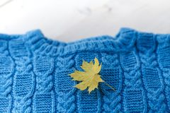 Fashion knitted handmade pullover sweater for the baby boy or girl with balls of wool and knitting needles Stock Photos