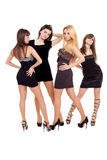 Fashion ladies. Image of three beauties in black dresses posing for photo Stock Photography