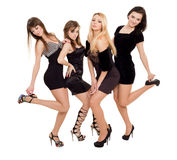 Fashion ladies. Image of three beauties in black dresses posing for photo Stock Images