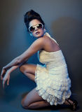 Fashion lady. In white dress with sunglasses Royalty Free Stock Photo