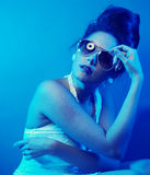 Fashion lady. With sunglasses in blue tones Stock Photography