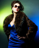 Fashion lady. With sunglasses over bright background Stock Images