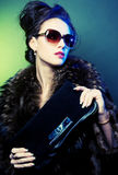 Fashion lady. With sunglasses over bright background Royalty Free Stock Photo