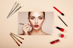 Fashion lady accessories collage. Falt Lay. Beauty photography. Make-Up brushes. Jewelry and nail polish. Beautiful woman paints lips with red lipstick. Nails Stock Photography