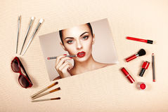 Fashion lady accessories collage. Falt Lay. Beauty photography. Make-Up brushes. Jewelry and nail polish. Beautiful woman paints lips with red lipstick. Nails Royalty Free Stock Photo