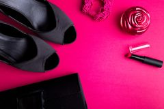 Fashion Lady Accessories Set. Black and pink. Minimal. Black Shoes, bracelet, perfume, lipstick and bag on pink background. Flat l. Ay Stock Photography