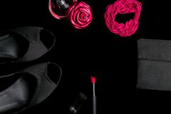 Fashion Lady Accessories Set. Black and pink. Minimal. Shoes, bracelet, perfume, lipstick and bag on black background. Flat lay. Fashion Lady Accessories Set Stock Photos