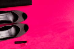Fashion Lady Accessories Set. Black and pink. Minimal. Black Shoes, lipstick and bag on pink background. Flat lay. Fashion Lady Accessories Set. Black and pink Stock Photography