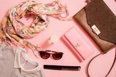 Fashion lady accessories set. Falt Lay. Stylish handbag. Make-Up brushes. Summer sunglasses. Jewelry and nail polish. Women access. Ories. Trendy fashion design stock photo