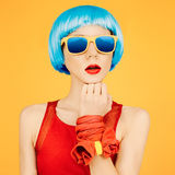 Fashion lady in blue wig and sunglasses Stock Photos