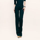 Fashion Lady in classic trousers and black blouse over white ba Royalty Free Stock Photos