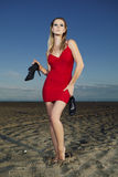 Fashion lady posing on the beach. Young and nice lady posing on the sand beach for fashion book photos in Italian resort Caorle royalty free stock photos