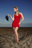 Fashion lady posing on the beach. Young and nice lady posing on the sand beach for fashion book photos in Italian resort Caorle royalty free stock photography