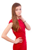 Fashion lady in red. Fashion studio shot of young and beautiful woman wearing red dress, on white background Royalty Free Stock Photo