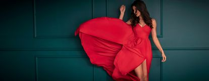 Fashion lady in red maxi dress royalty free stock image