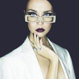 Fashion lady. Fashion studio portrait of beautiful woman with glasses Royalty Free Stock Photo