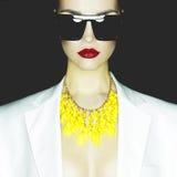 Fashion lady. Fashion studio portrait of beautiful woman with sunglasses Royalty Free Stock Photo