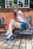 Fashion lady with sunglasses and short jean Stock Photography
