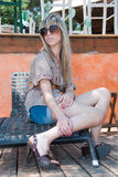 Fashion lady with sunglasses sitting on beach chair Stock Photo