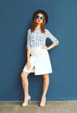 Fashion lady woman wearing a black sunglasses, hat and white skirt Royalty Free Stock Photos