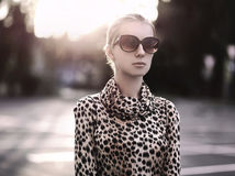 Fashion lady woman wearing a leopard dress with sunglasses. At evening city Royalty Free Stock Images