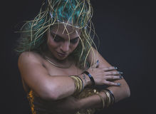 Fashion Latin woman with green hair and gold costume with handma Stock Images