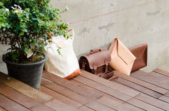 Fashion Leather Bags on Wood Step Floor Stock Photography