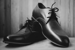 Fashion leather male shoes. Over grey Stock Image