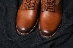 Fashion leather shoes, a dark sweater Royalty Free Stock Image