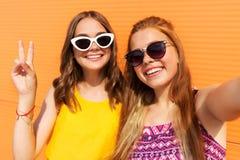Teenage girls taking selfie in summer Stock Photo