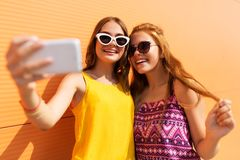 Teen girls taking selfie by smartphone in summer Royalty Free Stock Photography